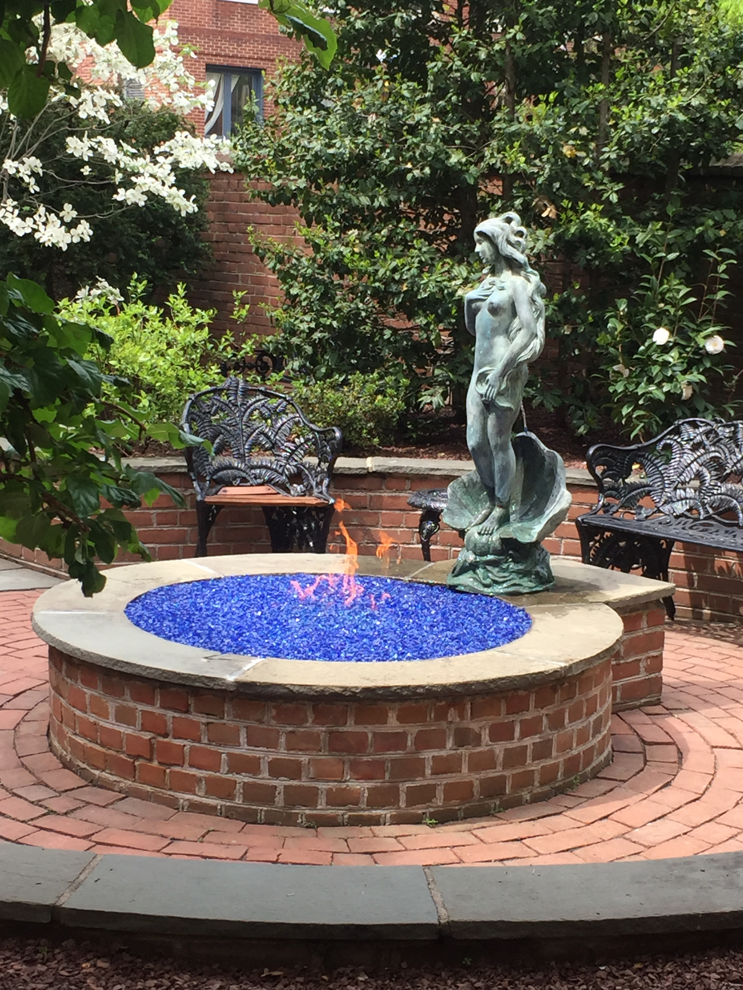 Creating a fire pit & statue with water in a center city garden